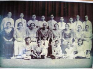 Family photo of the despedida for Avelina Ocampo (Sr. Mary Assumption) who is seated fourth from right.