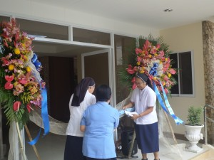 Untying of Ribbon led by Sr. Regina Kuizon, province leader, Sr. Edna Fuentes, Villa Maria local leader and Sr. Loreen Granada, in-charge of the retreat house