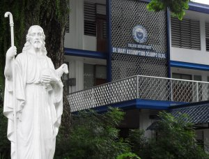 Statue_of_the_Good_Shepherd_in_front_of_College_Department_of_SBC._Building_is_named_after_the_first_Filipina_RGS,_Sr_._M_._Assumption_Ocampo_