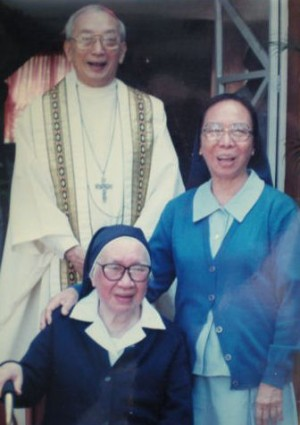 Sr. Assumption, seated, with her niece Sr. Teresita Feliciano RGS and nephew Bishop Federico Escaler SJ.